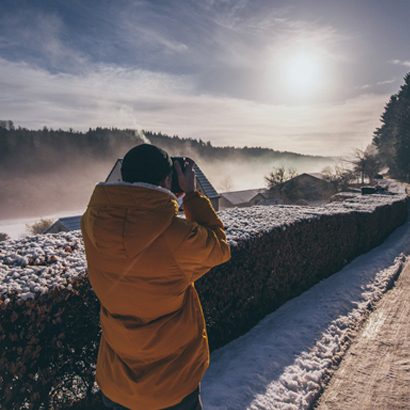 Man Photographing Winter Landscape.