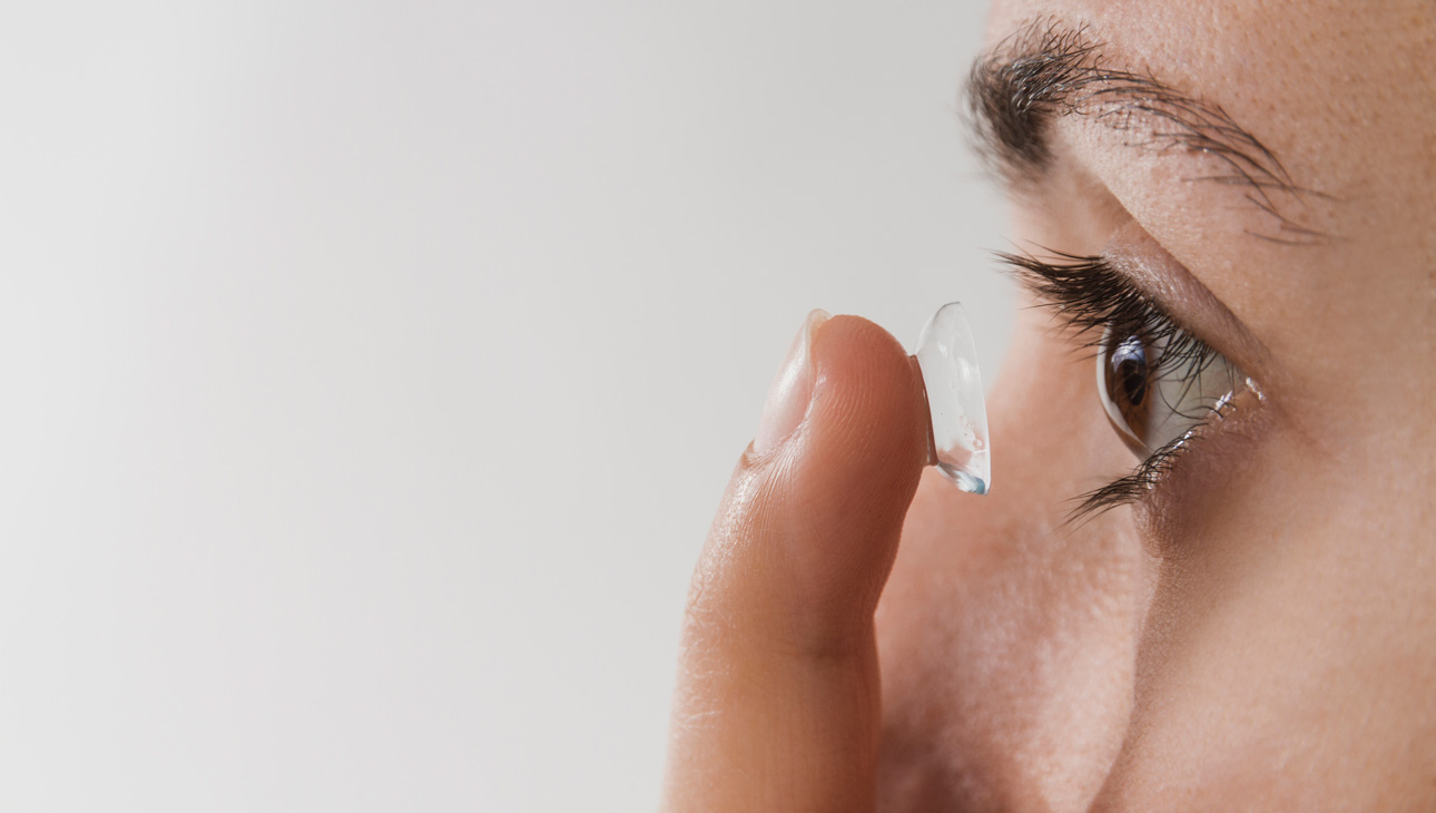 Person Inserting A Contact Lens.
